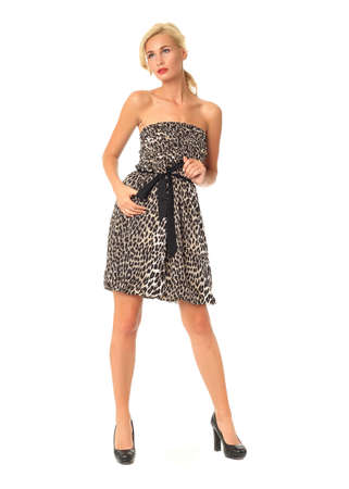 Full length of flirtatious woman in leopard dress isolated Stock Photo
