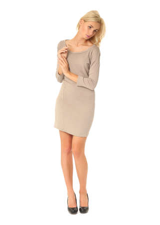 Full length of flirtatious woman in tight dress isolated