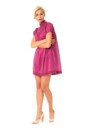Portrait of flirtatious woman in short burgundy dress isolated