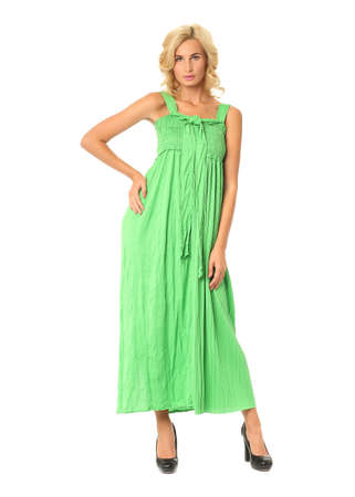 Portrait of flirtatious woman in green maxi dress isolated