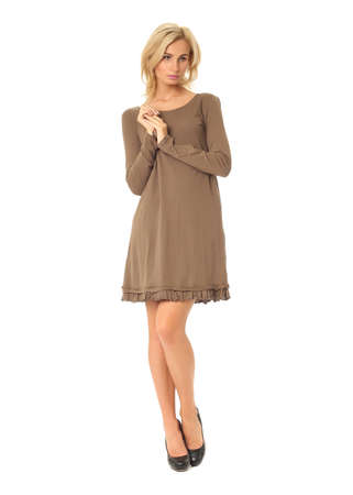 Full length of flirtatious woman in short dress isolated