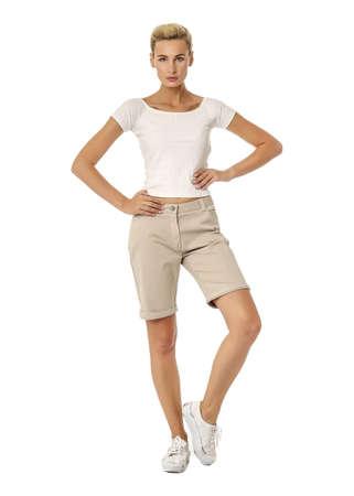 Beautiful woman blonde pose in beige breeches