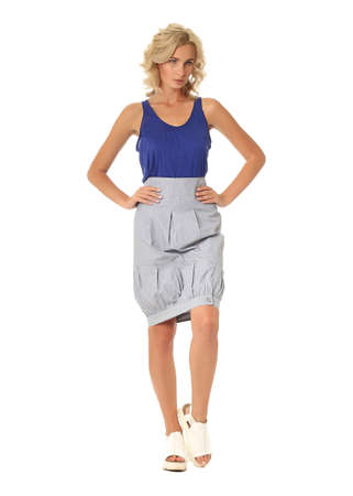 Blond model with luxury hair and gray skirt