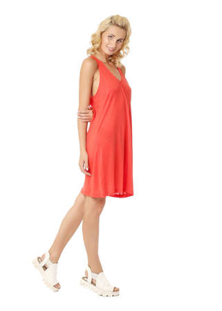 Full length of flirtatious woman with red dress isolated