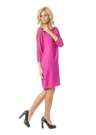 Portrait of flirtatious woman in pink silk dress isolated