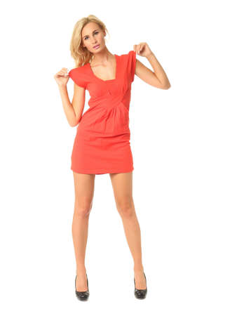 Portrait of flirtatious woman in short red dress isolated