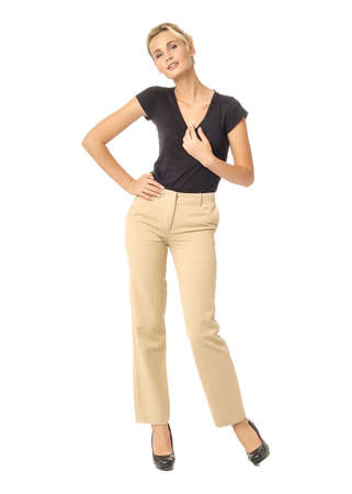 Blond fashion model girl stand in light brown trousers