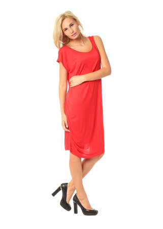 Full length of flirtatious woman in red dress isolated