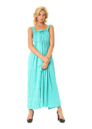 Portrait of flirtatious woman in turquoise maxi dress isolated