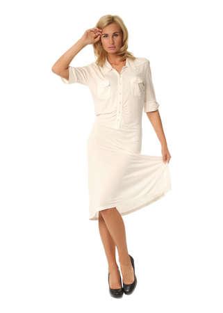 Full length of flirtatious woman in white dress isolated Stock Photo
