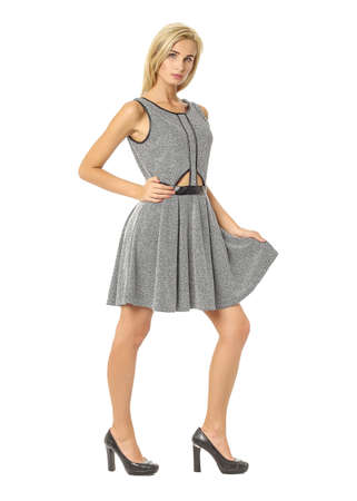 Portrait of flirtatious woman in gray dress isolated