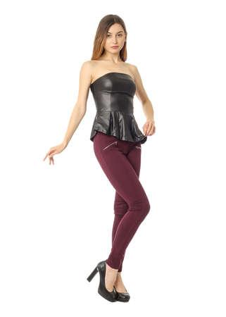 Studio shot of attractive brunette woman in corset