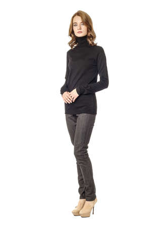 Young brunette woman standing in gray jeans
