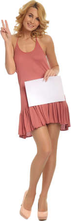 Beautiful young woman holding blank sign Stock Photo