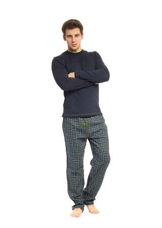 Young healthy man in pijamas isolated on white