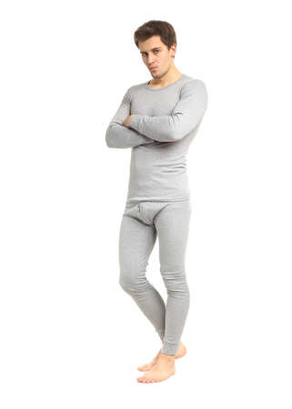 Strong fit man in long underwear isolated