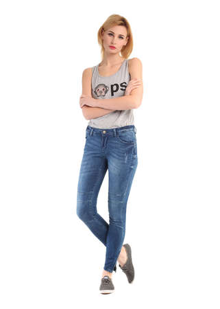 cheer full: Girl standing in blue jeans and gray sleeveless shirt
