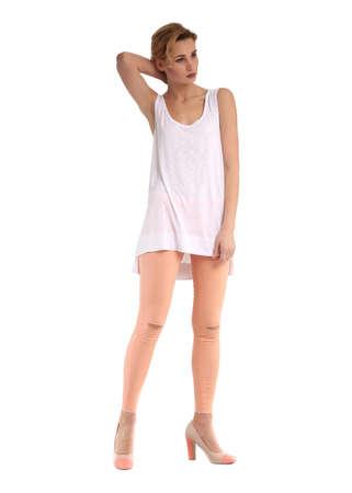 Girl in full length standing in knee slit jeans Stock Photo