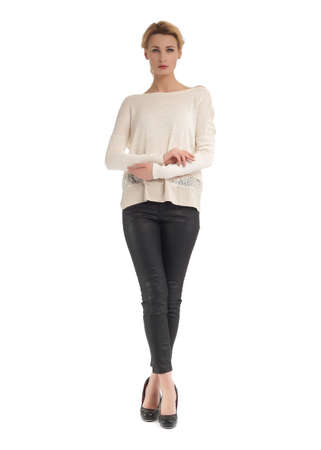 Attractive woman in black leather pants and white blouse Stock Photo