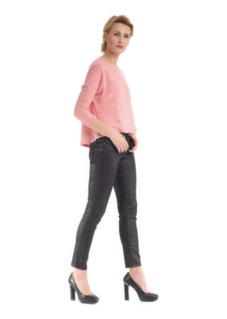 Attractive woman in black leather pants and pink blouse Stock Photo