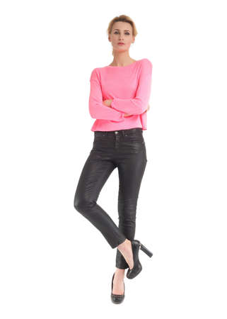 indignant: Attractive woman in black leather pants and pink blouse Stock Photo