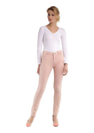 Girl in full length standing in pink skinny jeans Stock Photo