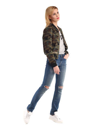 Girl in full length standing in torn boyfriend jeans