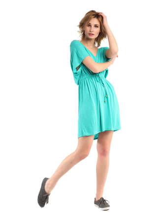 Portrait of flirtatious woman in turquoise tunic dress isolated Stock Photo