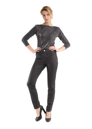 Attractive woman in black leather pants posing on white background Stock Photo