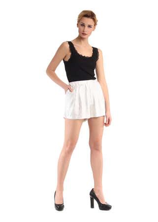 Blond woman in mini skirt, full body length