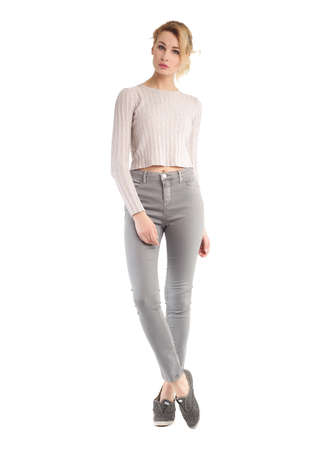 Girl in full length standing in gray skinny jeans Reklamní fotografie