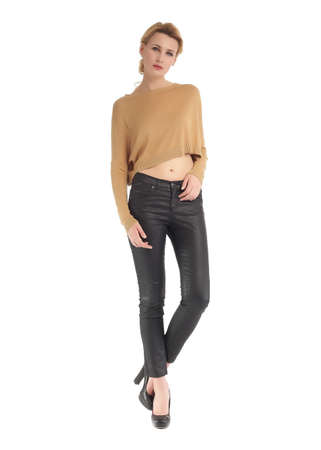 Attractive woman in black leather pants and brown top
