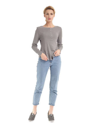 Girl in rolled up boyfriend jeans and sleeve shirt Stock Photo