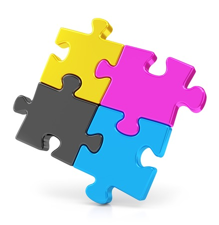Four colorful CMYK puzzle pieces isolated on white background. Teamwork and offset print concept. photo