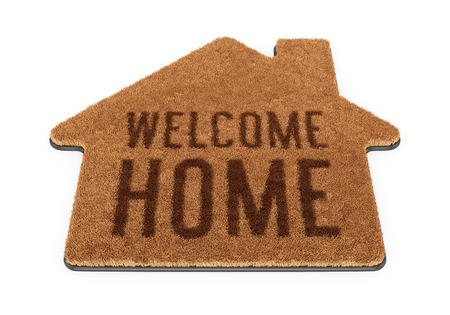 Brown house shape coir doormat with text Welcome Home isolated on white background Foto de archivo