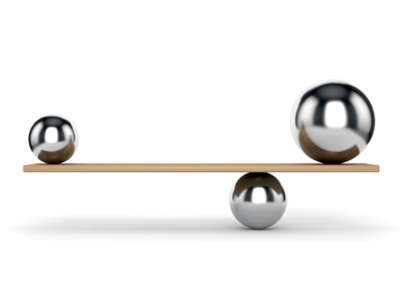 Abstract balance and harmony concept. Metal balls on plank isolated on white background.