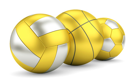 Sport team game success and award concept. Gold and silver volleyball, basketball and soccerball in row. photo