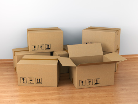moving box: Moving in concept: group of cardboard boxes in empty room