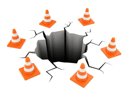 Road cones around black cracked ground isolated on white. Accident, failure and web site under construction concept.