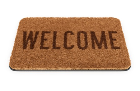 Brown coir doormat with text Welcome isolated on white background