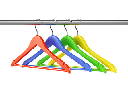 white coats: Colorful hangers on horizontal metal clothes rail over white background Stock Photo