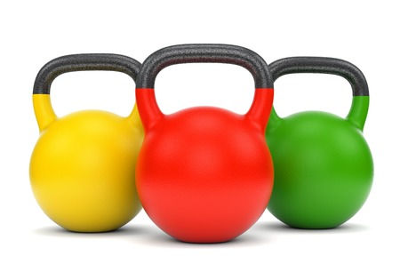 Three gym weight kettle bells isolated on white background photo