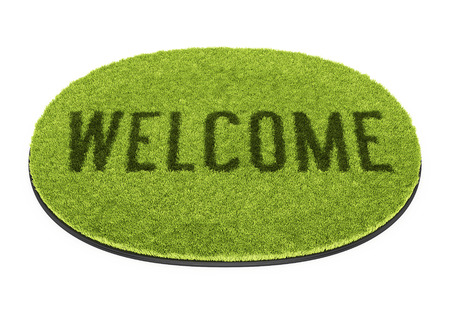Green oval doormat with text Welcome isolated on white background photo