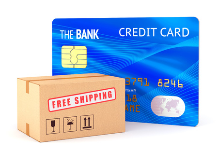 Cardboard box and bank credit card isolated on white background. Online shopping, e-commerce technology and business concept. photo