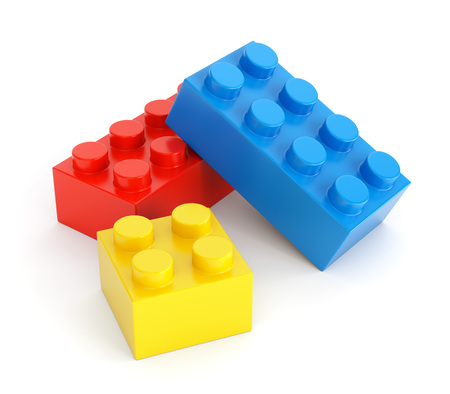 building bricks: Toy building blocks. Group of colorful plastic bricks isolated on white background. 3D illustration
