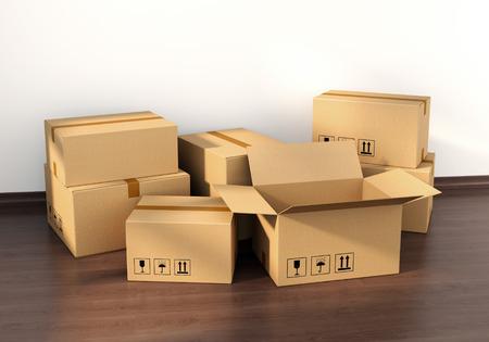 새 집 인테리어에서 나무 바닥에 골 판지 상자입니다. 주택, 부동산 및 이동 개념입니다.