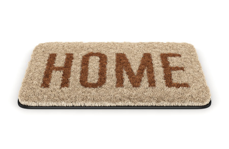 Brown coir doormat with text Home isolated on white background photo