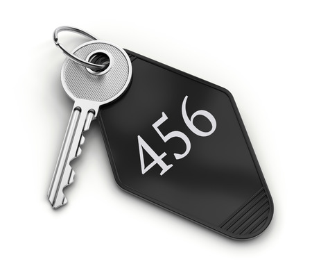 key fob: Hotel room key with number isolated on white background.
