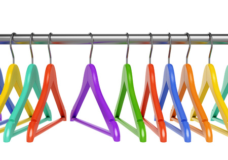 clothes rail: Set of colorful wooden cloth hangers on clothes rail on white background