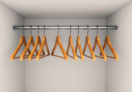 clothes rail: Wooden cloth hangers on clothes rail in wardrobe
